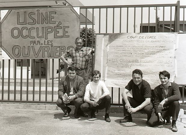 French workers with placard during occupation of their factory 1968